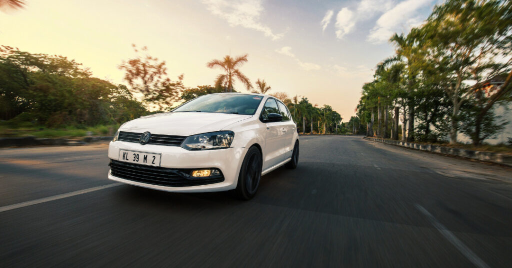 Modified White Volkswagen Polo GT with alloy wheels